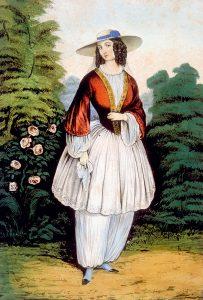 Historia de la mujer y la bicicleta: Amelia Bloomer vestida con pantalones bombachos (bloomers).